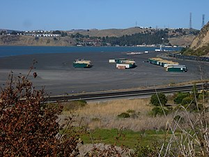 Rodeo, California - Containers beached on the outskirts of Rodeo with Vallejo and Cal Maritime in the background.