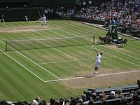 Nadal serves to Federer during the 2006 Wimbledon final
