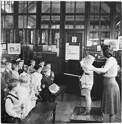 A music teacher leading a music ensemble in an elementary school in 1943. Roman Catholic Elementary School- Life at St Joseph's, Upper Norwood, 1943 D14456.jpg