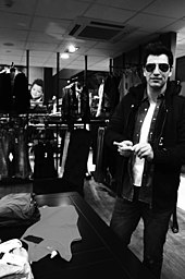 Man in sunglasses in a clothing store