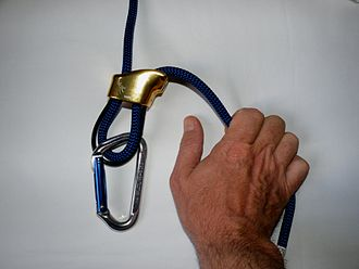 Belaying - A demonstration of the belay device with rope and carabiner without a proper locking gate