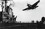 SB2C-4E Helldiver of VT-74 flies over USS Midway (CVB-41) in 1946.jpg