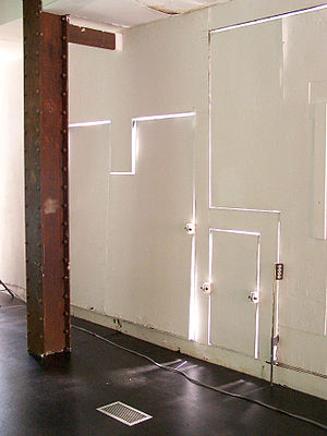 Storefront for Art and Architecture - Sunlight shining through the cracks between the wall panels
