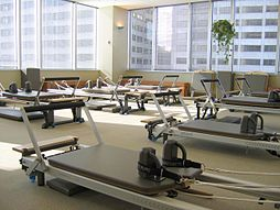 A group of reformers at the Stott Pilates Training Center, 2200 Yonge Street, Toronto, Ontario.