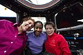STS-131 group pose with Stephanie Wilson in Cupola.jpg