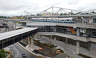 SeaTac/Airport station - View of the station from the adjacent parking garage, showing the pedestrian bridge leading towards the airport's main terminal