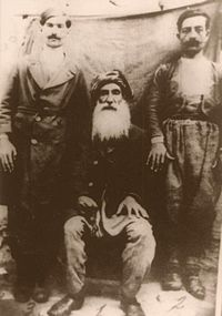 Seyid Riza with his sons.jpg