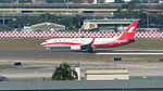 Shanghai Airlines Boeing 737-86D B-1720 Taking off from Taipei Songshan Airport 20150104a.jpg