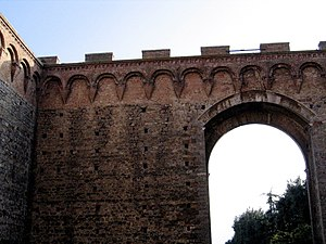 Blind arch - Blind arches in the form of a Lombard band on a wall in Siena (Italy).