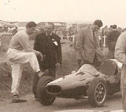 1956 Silverstone GP Formula 2 race winner Salvadori with foot on tyre of Cooper T41