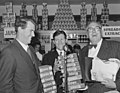 Sir Edmund Hillary, Selwyn Toogood, and Joseph Holmes Miller, with give away Rinso products at the opening week of the Self Help store, Lambton Quay, Wellington, 1956.jpg