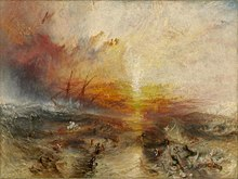 "A painting entitled ""The Slave Ship"" by J. M. W. Turner. In the background, the sun shines through a storm while large waves hit the sides of a sailing ship. In the foreground, enslaved people are drowning in the water, while others are being eaten by large fish"
