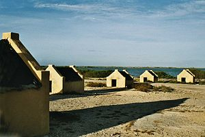 Slavery in the British and French Caribbean - Slave huts in Bonaire at the Salt evaporation pond)