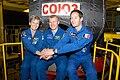 Soyuz MS-01 backup crew members in front of the spacecraft.jpg
