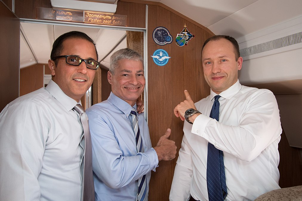 Soyuz MS-06 crew aboard a Russian Federal Space Agency aircraft.jpg