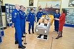 Soyuz MS-11 crew and backup crew at the Baikonur Cosmodrome Museum.jpg