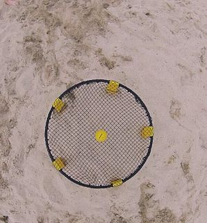 Roundnet Ball sport with racket and net