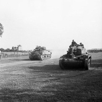 Staffordshire Yeomanry - Sherman tank and Crusader AA Mk III of the Staffordshire Yeomanry during Operation Goodwood, July 1944.