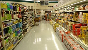 A view down the beer and wine aisle of a super...