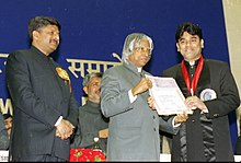 The President Dr. A.P.J. Abdul Kalam presenting the Best Music Direction Award for the year 2002 to A. R. RAHMN for the Tamil Film Kannathil Muthamittal for his original musical score highlighting the cultural conflicts and.jpg