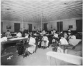 The School sewing room. Indian girls receive instruction in sewing, dressmaking, fancy sewing, drafting, darning... - NARA - 298641.tif