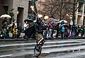 The Unipiper dressed as Darth Vader playing the flaming bagpipes while riding a unicycle in the city of Vancouver BC's St. Patrick's Parade.jpg