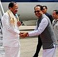 The Vice President, Shri M. Venkaiah Naidu being received by the Chief Minister of Madhya Pradesh, Shri Shivraj Singh Chouhan, on his arrival, in Bhopal, Madhya Pradesh on May 16, 2018.JPG