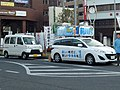 "The frontview of Toyota PIXIS VAN Special""SA III"" (HBD-S321M-ZQRFU(S)) and Mazda PREMACY 20C (DBA-CWEAW) used as an election campaign car by Kiyoshige Maekawa.jpg"