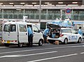 "The rearview of Toyota PIXIS VAN Special""SA III"" (HBD-S321M-ZQRFU(S)) and Mazda PREMACY 20C (DBA-CWEAW) used as an election campaign car by Kiyoshige Maekawa.jpg"