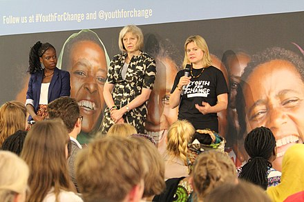 May and Justine Greening speaking at Youth For Change, 19 July 2014 Theresa May and Justine Greening speaking at -YouthForChange (14503114089).jpg