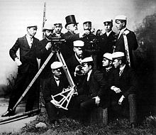 Uniformed group poses with theodolites, level staves and octant.