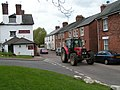 Tractor passing the Golden Lion Inn, Tipton St John - geograph.org.uk - 1285999.jpg