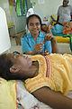 Trainee nurse Teinan Tewe Kamiro with patients at South Tarawa Hospital. Kiribati 2007. Photo- Lorrie Graham (10730434616).jpg