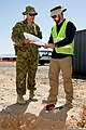 Travis Collins, right, the environmental officer with the Force Extraction Unit at Multinational Base Tarin Kowt, and Australian Army Sgt. Thomas Allison, a surveyor with the unit, confer as Collins works on 130704-O-MD709-019-AU.jpg