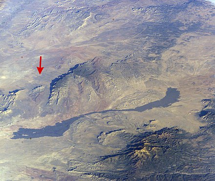 Trinity Site (red arrow) near Carrizozo Malpais TrinitySiteISS008-E-5604.jpg