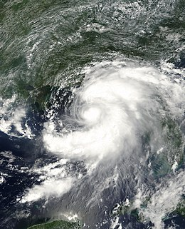 Tropical Storm Barry viewed from Space on August 6, 2001. The storm is approaching the Florida Panhandle. At the bottom of the image is the Yucatan Peninsula, while Cuba is seen on the right. The image is focused on the Gulf of Mexico.