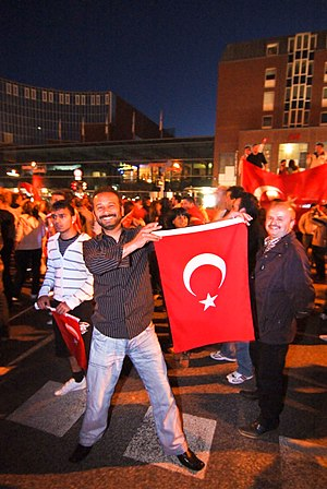 Turks in Germany - German Turks holding the flag of Turkey in Kiel.
