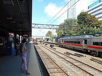 New Rochelle station - Two Metro-North M8's arrive at New Rochelle station in both directions in September 2015.