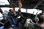 U.S. Air Force Capt. William Cerat, left, a C-17 Globemaster III pilot assigned to the 6th Airlift Squadron, starts his aircraft's engines April 26, 2012, at Joint Base McGuire-Dix-Lakehurst, N.J. Cerat 120426-F-CA540-021.jpg