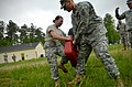 U.S. Army Pfc. Tania Simmons, left, with the 1132nd Military Police Company, North Carolina Army National Guard, makes her way through a defense course during oleoresin capsicum familiarization training at Camp 130501-Z-AY498-015.jpg