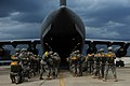 U.S. Army paratroopers with the 1st Brigade Combat Team, 82nd Airborne Division board an Air Force C-17 Globemaster III aircraft for airborne operations June 27, 2013, during Joint Operational Access Exercise 130627-F-GO452-114.jpg
