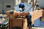 U.S. Coast Guard Petty Officer 2nd Class David Duenow and Chief Petty Officer Christopher Williams, aboard the seagoing buoy tender USCGC Alder (WLB 216), install a new cable on the vessel's crane in 130801-G-ZZ999-006.jpg