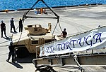 U.S. Navy Sailors attach hooks to a Humvee before its transported by the ship's crane to the flight deck aboard amphibious dock landing ship USS Tortuga (LSD 46) Aug. 21, 2012, in Okinawa, Japan 120821-N-XZ031-128.jpg