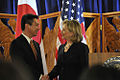 U.S. Secretary of State Hillary Rodham Clinton, right, and Japanese Foreign Minister Seiji Maehara shake hands after a joint press conference of American and Japanese journalists held at the Kahala Resort 101027-F-LX971-111.jpg