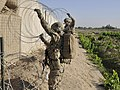 U.S. Soldiers assigned to Charlie Company, 4th Battalion, 9th Infantry Regiment set up concertina wire during a base defense patrol at Forward Operating Base Zangabad in Panjwai district, Kandahar province 130523-A-MX357-017.jpg