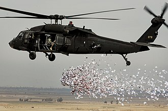 Information Operations (United States) - Soldiers from the U.S. Army's 350th Tactical Psychological Operations, 10th Mountain Division, drop leaflets over a village near Hawijah in Kirkuk province, Iraq, on March 6, 2008.