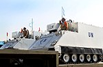 UN peacekeepers from Iran with UN APCs.jpg
