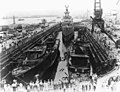 USS Cassin (DD-372), USS Downes (DD-375) and USS Raleigh (CL-7) in drydock at Pearl Harbor 1942.jpg