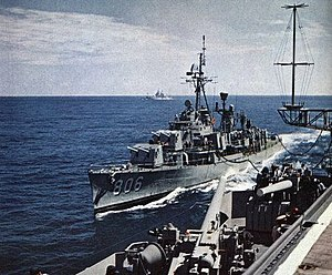 USS Higbee (DDR-806) being refueled by USS Ticonderoga (CVA-14), in 1960