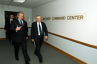 National Military Command Center - President George W. Bush and Secretary of Defense Donald H. Rumsfeld walk from the Pentagon's National Military Command Center where they received operational briefings on March 23, 2003.